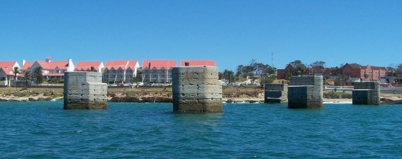 View from the sea: old slipway and hotels